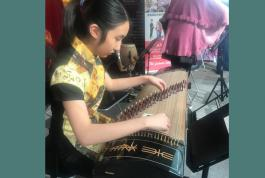 a young girl playing a musical instrument